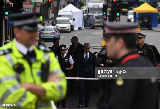 Mayor of London Sadiq Khan and Metropolitan Police Commissioner Cressida Dick walk along Borough High Street in London on June 5 as the visit the...