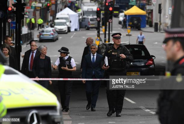 Mayor of London Sadiq Khan and Metropolitan Police Commissioner Cressida Dick walk along Borough High Street in London on June 5 as they visit the...