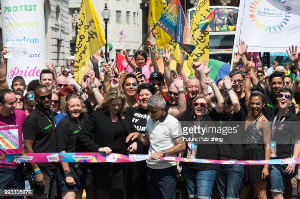 Mayor of London Sadiq Khan and Secretary of State for International Development Penny Mordaunt cut the flag to officially launch the Pride in London...
