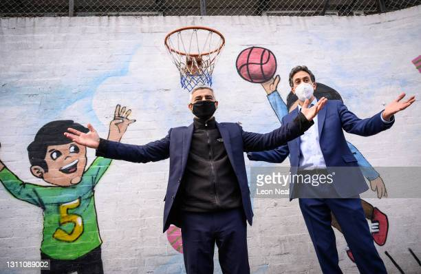 Mayor of London Sadiq Khan celebrates with Shadow Secretary of State for Business, Energy and Industrial Strategy Ed Miliband after scoring a reverse...