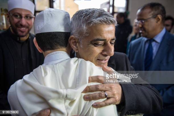 Mayor of London Sadiq Khan embraces a Muslim cultural leader during a visit to Al Manaar mosque on Visit My Mosque Day on February 18 2018 in London...