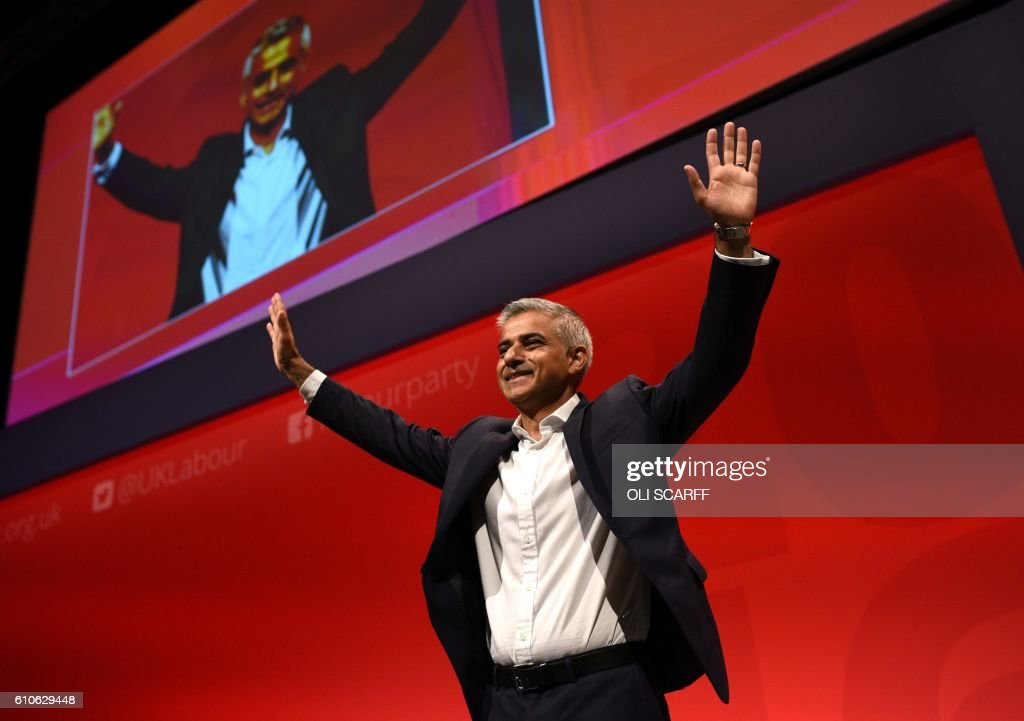 TOPSHOT - Mayor of London Sadiq Khan gestures to the audience after making a speech on the third day of annual Labour Party conference in Liverpool, north west England on September 27, 2016. Distracted by a bitter leadership contest, Britain's main opposition Labour party has struggled to present a vision of Brexit to challenge the ruling Conservatives -- and many fear the re-election of Jeremy Corbyn will do little to change this. / AFP PHOTO / Oli SCARFF
