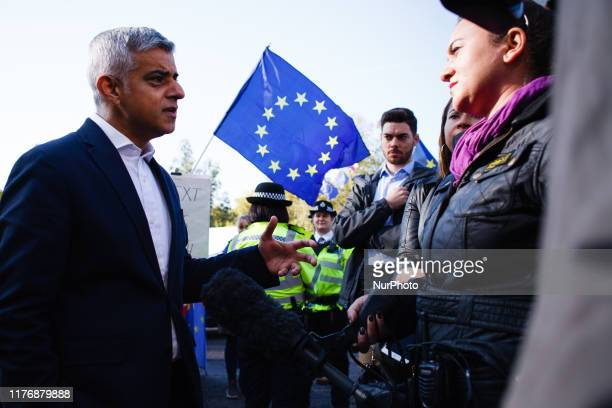 Mayor of London Sadiq Khan gives an interview as demonstrators gather on Park Lane for the mass 'Together for the Final Say' march organised by the...