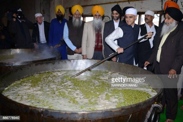 Mayor of London Sadiq Khan helps prepare food for a communal vegetarian meal in a community kitchen during his visit to the Golden Temple in Amritsar...