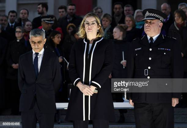 Mayor of London Sadiq Khan Home Secretary Amber Rudd MP and acting Commissioner of the Metropolitan Police Craig Mackey stand in silence during a...