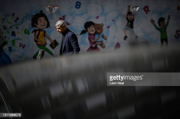 Mayor of London Sadiq Khan is reflected in the roof of a car as he is interviewed during a campaign visit to Fairfield Play Centre on April 06, 2021...