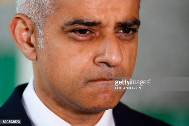 TOPSHOT Mayor of London Sadiq Khan leaves after observing a minutes' silence with London ambulance staff in London on June 6 in memory of the victims...
