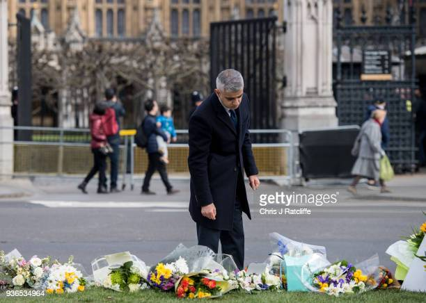 Mayor of London Sadiq Khan looks at floral tributes in Parliament Square on the first anniversary of the Westminster Bridge terror attack on March 22...