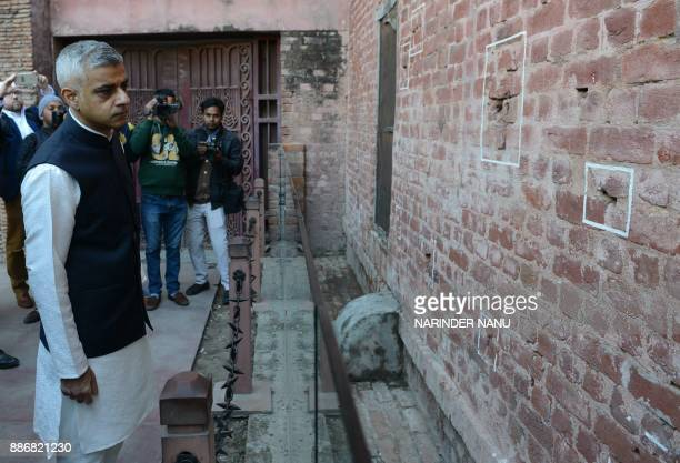 Mayor of London Sadiq Khan looks at the bullet marks on a wall during his visit at Jallianwala Bagh in Amritsar on December 6 2017 The Jallianwala...