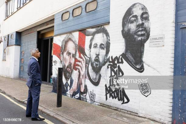 Mayor of London Sadiq Khan poses for a photo in front of a new mural by Murwalls, honouring members of the England football team, on July 13, 2021 in...