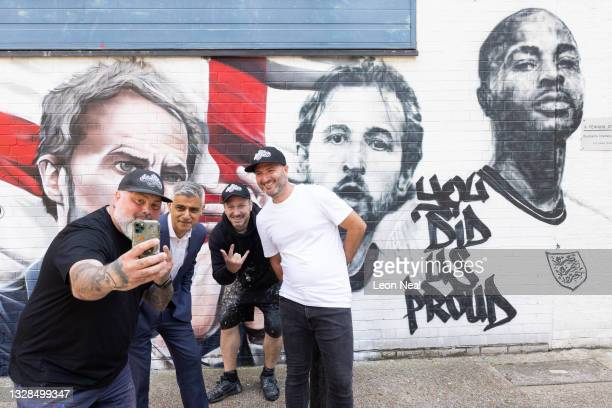 Mayor of London Sadiq Khan poses for a selfie with artists Mr Meana , Gnasher and Murwalls owner Marc Silver in front of a new mural honouring...