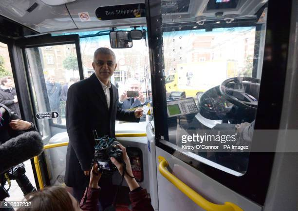 Mayor of London Sadiq Khan taps his oyster card whilst taking the bus to City Hall to mark the first day of the unlimited Hopper fare which allows...