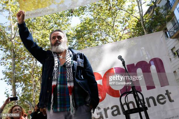 Mayor of Marinaleda Juan Manuel Sanchez Gordillo raises his fist during a political meeting organised by the local leftwing party 'Som Gramenete' on...