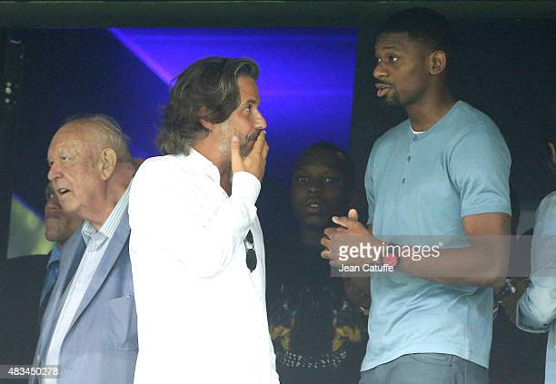 Mayor of Marseille JeanClaude Gaudin President of OM Vincent Labrune and OM new signing Abou Diaby attend the French Ligue 1 match between Olympique...