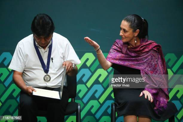 Mayor of Mexico City Claudia Sheinbaum and former president of Bolivia Evo Morales gesture during an event to distinguish Evo Morales as honorary...