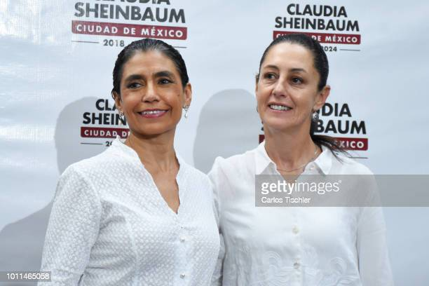 Mayor of Mexico City Claudia Sheinbaum and Oliva Lopez Arellano pose for photos during a press conference to announce the new Mexico City's cabinet...