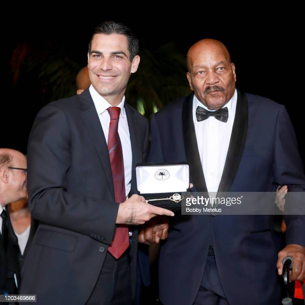 Mayor of Miami Francis X Suarez and Jim Brown attend 2020 Big Game Big Give at Star Island on February 01 2020 in Miami Florida
