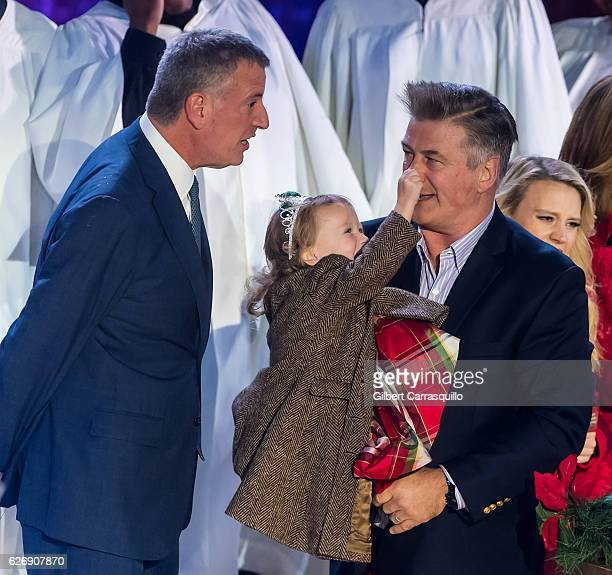 Mayor of New York City Bill de Blasio and actor Alec Baldwin with his daughter Carmen Gabriela Baldwin on stage during the 84th Rockefeller Center...