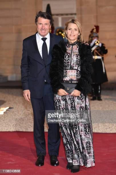 Mayor of Nice Christian Estrosi and his wife Laura Tenoudji arrive for a state dinner at the Elysee Presidential Palace on March 25 2019 in Paris...