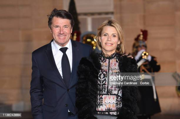 Mayor of Nice Christian Estrosi and his wife Laura Tenoudji arrive for a state dinner at the Elysee Presidential Palace on March 25, 2019 in Paris,...