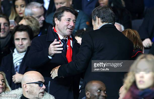 Mayor of Nice Christian Estrosi greets former French President Nicolas Sarkozy before the French Ligue 1 match between Paris Saint Germain and OGC...