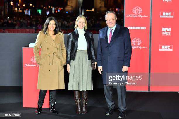 Mayor of Paris Anne Hidalgo, actress Ludivine Sagnier and Jean-Noël Reinhardt attend Christmas Lights Launch On The Champs Elysees In Paris on...