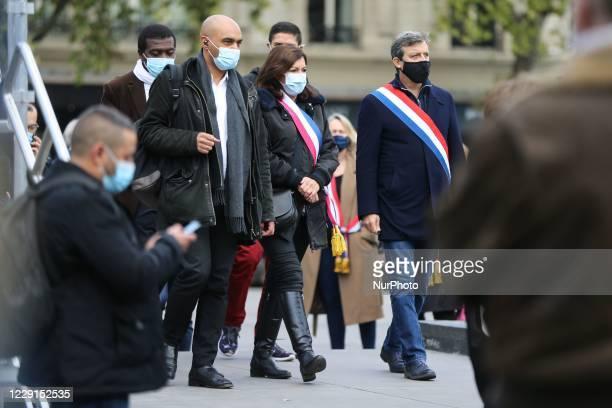 Mayor of Paris Anne Hidalgo and Head of SOS Racisme anti-racist NGO Dominique Sopo arrive as people gather on Place de la Republique in Paris on...
