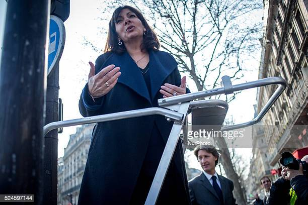 Mayor of Paris Anne Hidalgo and JeanCharles Decaux chairman of the board and coCEO of multinational advertising corporation JCDecaux during the...