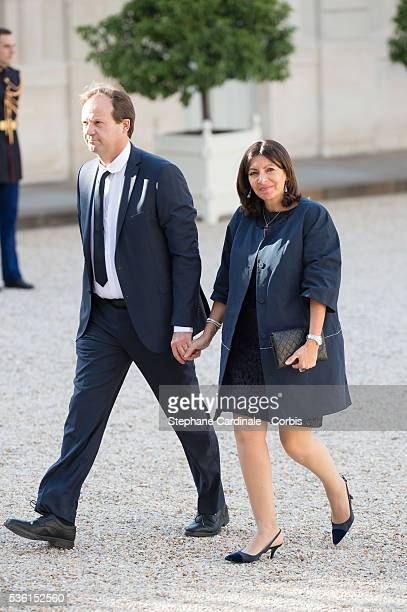 Mayor of Paris Anne Hidalgo and Politician JeanMarc Germain arrive at the State Dinner offered by French President François Hollande at the Elysee...