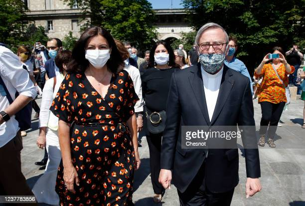 Mayor of Paris Anne Hidalgo and Rector of NotreDame de Paris Patrick Chauvet wearing protective face masks walk on Pentecost Sunday on the square of...