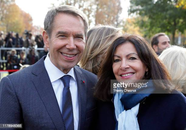 """Mayor of Paris, Anne Hidalgo and U.S. Artist, Jeff Koons pose prior to the unveiling of a creation entitled""""Tulips bouquet"""" by Jeff Koons next to..."""