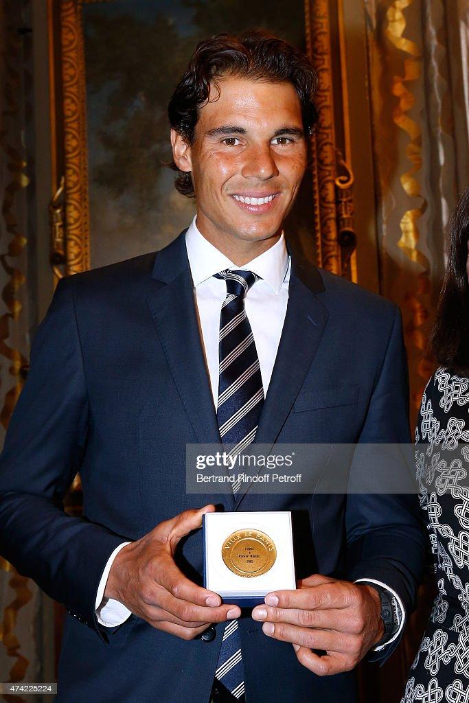 Mayor of Paris Anne Hidalgo Awards the 'Grand Vermeil' Medal to Tennis player Rafael Nadal at Mairie de Paris on May 21, 2015 in Paris, France.