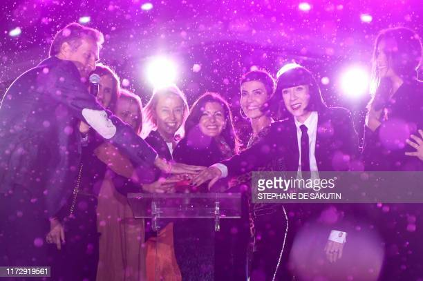 TOPSHOT Mayor of Paris Anne Hidalgo Brazilian tv host Cristina Cordula French fashion designer Chantal Thomas Miss France 2019 Vaimalama Chaves and...