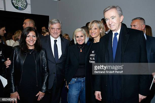 Mayor of Paris Anne Hidalgo CEO Dior Sidney Toledano Stylist Maria Grazia Chiuri Owner of LVMH Luxury Group Bernard Arnault and his wife Helene...