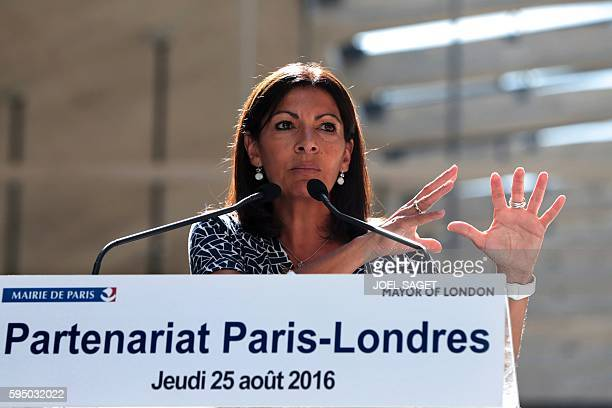 mayor of Paris Anne Hidalgo delivers a speech next to the mayor of London during a joint press conference following their visit of the Station F the...