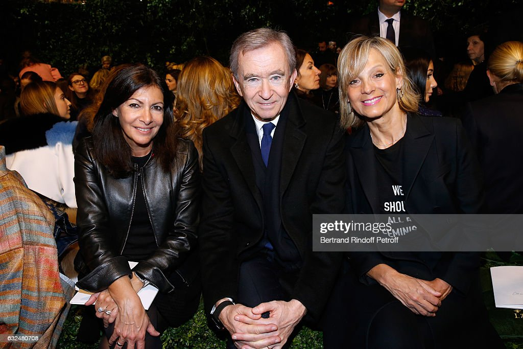 Mayor of Paris Anne Hidalgo, Owner of LVMH Luxury Group Bernard Arnault and his wife Helene Arnault attend the Christian Dior Haute Couture Spring Summer 2017 show as part of Paris Fashion Week on January 23, 2017 in Paris, France.
