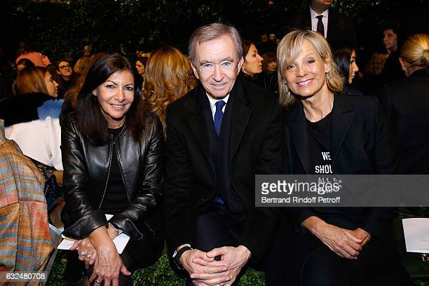 Mayor of Paris Anne Hidalgo, Owner of LVMH Luxury Group Bernard Arnault and his wife Helene Arnault attend the Christian Dior Haute Couture Spring...
