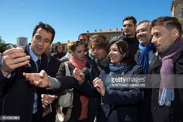 Mayor of Paris Anne Hidalgo poses for a selfie with French slalom canoeist and copresident of the French National Olympic and Sports Committee of...