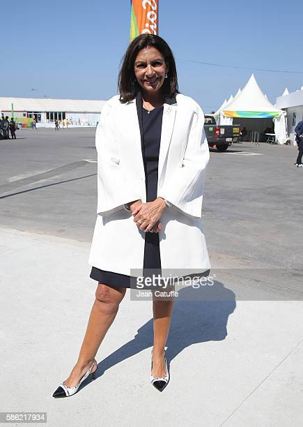 Mayor of Paris Anne Hidalgo poses with the Paris 2024 uniform following a press conference given by the Paris 2024 Candidate Olympic City delegation...