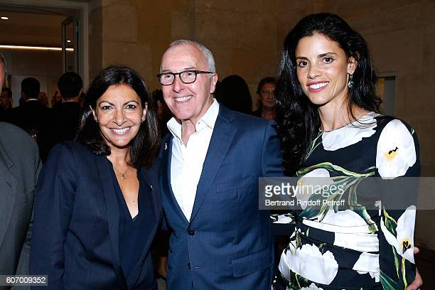 Mayor of Paris Anne Hidalgo President of the Olympique de Marseille Football Club Frank McCourt and his wife Monica McCourt attend the 4O Rue de...