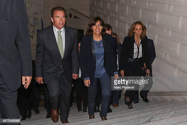 Mayor of Paris Anne Hidalgo receives Arnold Schwarzenegger at Hotel de Ville on October 11 2014 in Paris France Schwarzenegger's R20 organisation a...
