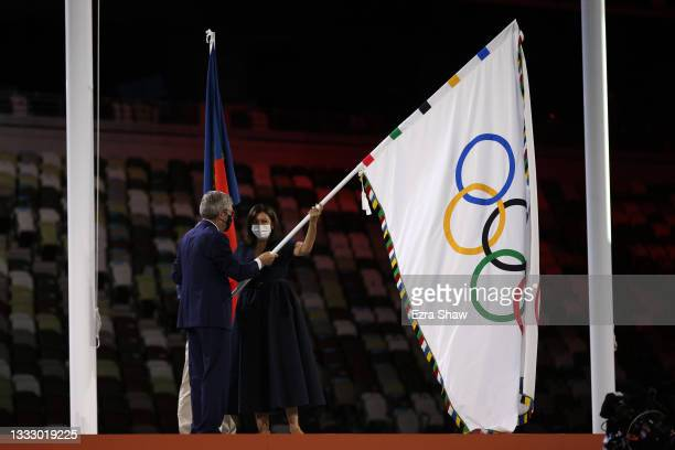 Mayor of Paris, Anne Hidalgo receives the olympic flag from President of the International Olympic Committee, Thomas Bach during the Closing Ceremony...