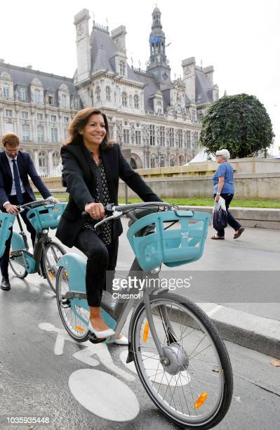 Mayor of Paris Anne Hidalgo rides a new electric cycle Velib Metropole next to the Paris city hall on September 19 2018 in Paris France On the...