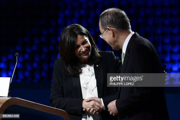 Mayor of Paris Anne Hidalgo shakes hands with Former United Nations secretarygeneral Ban KiMoon during the One Planet Summit on December 12 2017 at...