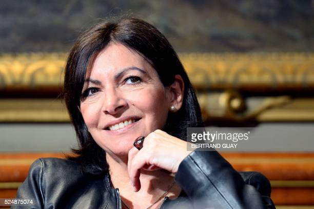 Mayor of Paris Anne Hidalgo smiles during a press conference to announce an art museum project within the Bourse du Commerce building in central...