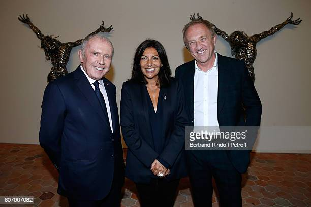 Mayor of Paris Anne Hidalgo standing between Francois Pinault and his son CEO of Kering Group FrancoisHenri Pinault attend the 4O Rue de Sevres...