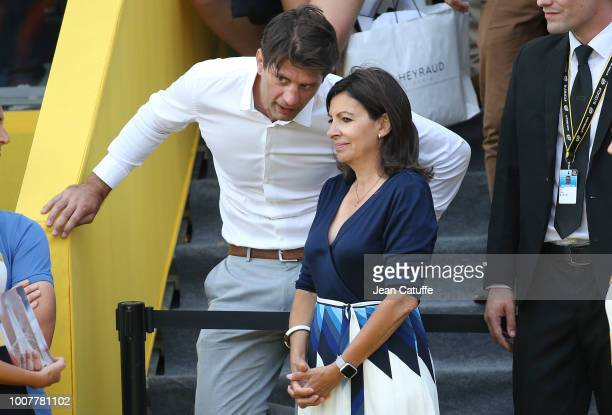 Mayor of Paris Anne Hidalgo talks to Pierre Rabadan following stage 21 of Le Tour de France 2018 between Houilles and Paris avenue des ChampsElysees...
