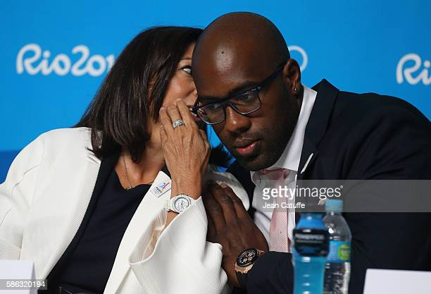 Mayor of Paris Anne Hidalgo talks to Teddy Riner of France during a press conference given by the Paris 2024 Candidate Olympic City delegation at...