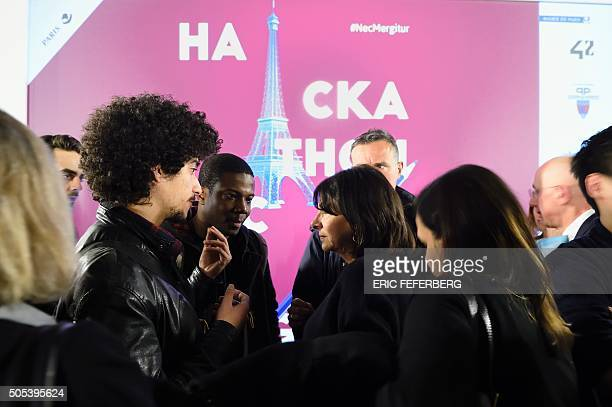 Mayor of Paris Anne Hidalgo talks with students of the the private computer programming school 42 after the closure ceremony of the Hackathon Nec...