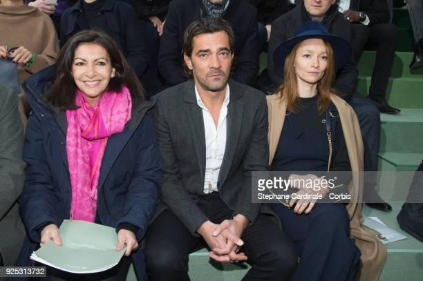 Mayor of Paris Anne Hidalgo Thierry Guibert and Audrey Marnay attend the Lacoste show as part of the Paris Fashion Week Womenswear Fall/Winter...